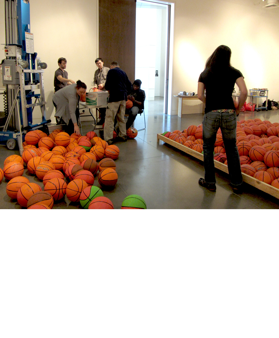 Inflating the basketballs for artist David Huffman's project Pyramid 3